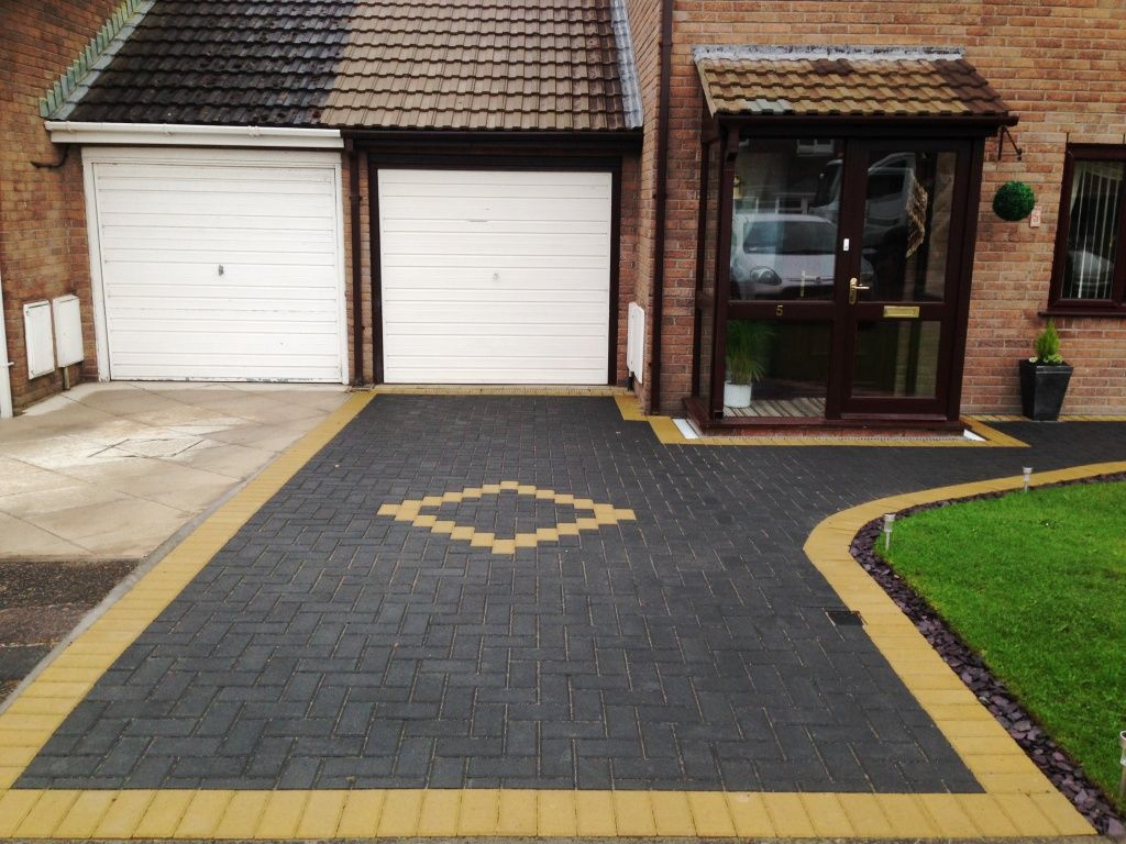 Block paving in charcoal with buff borders in westgate for Front garden block paving designs