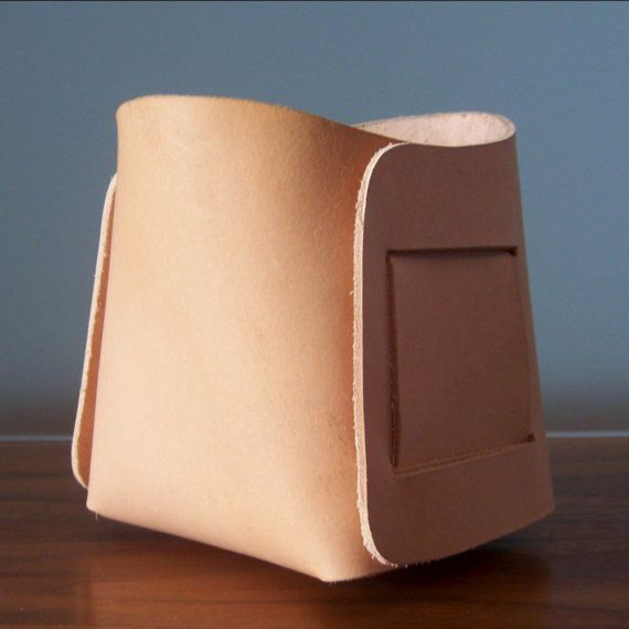 Small bin made of one piece of leather.