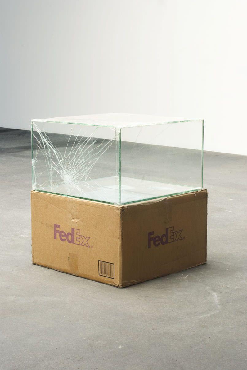 Artist ships glass boxes using fedex to make broken