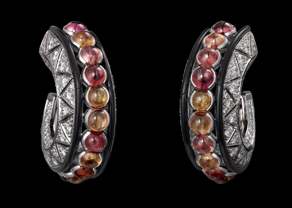 Platinum, cabochon-cut orange sapphires, onyx, brilliants