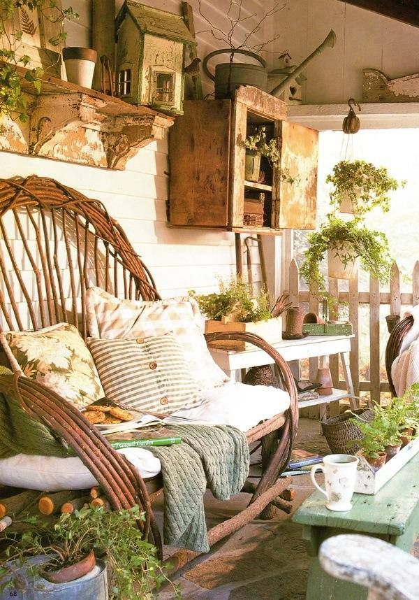 A Rustic Country Garden Porch With Shelves And A Cabinet - via The Vintage House