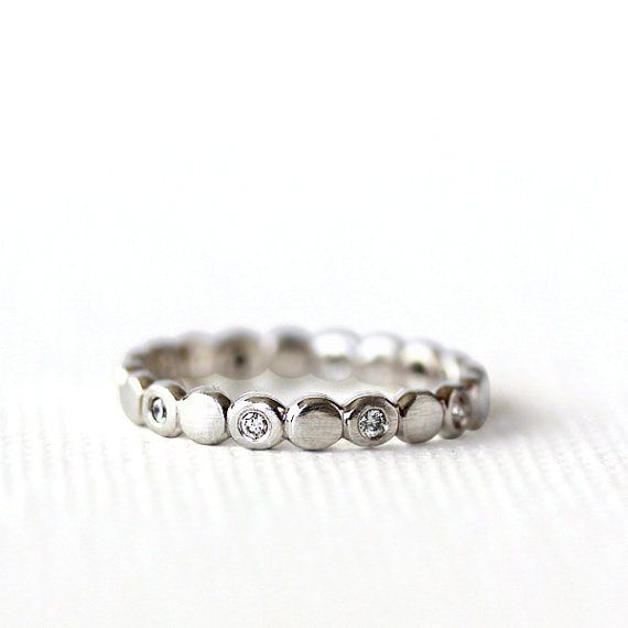 This diamond gold eternity band is stunning! By Andrea Bonelli. |  http://emmalinebride.com/jewelry/handmade-wedding-bands/