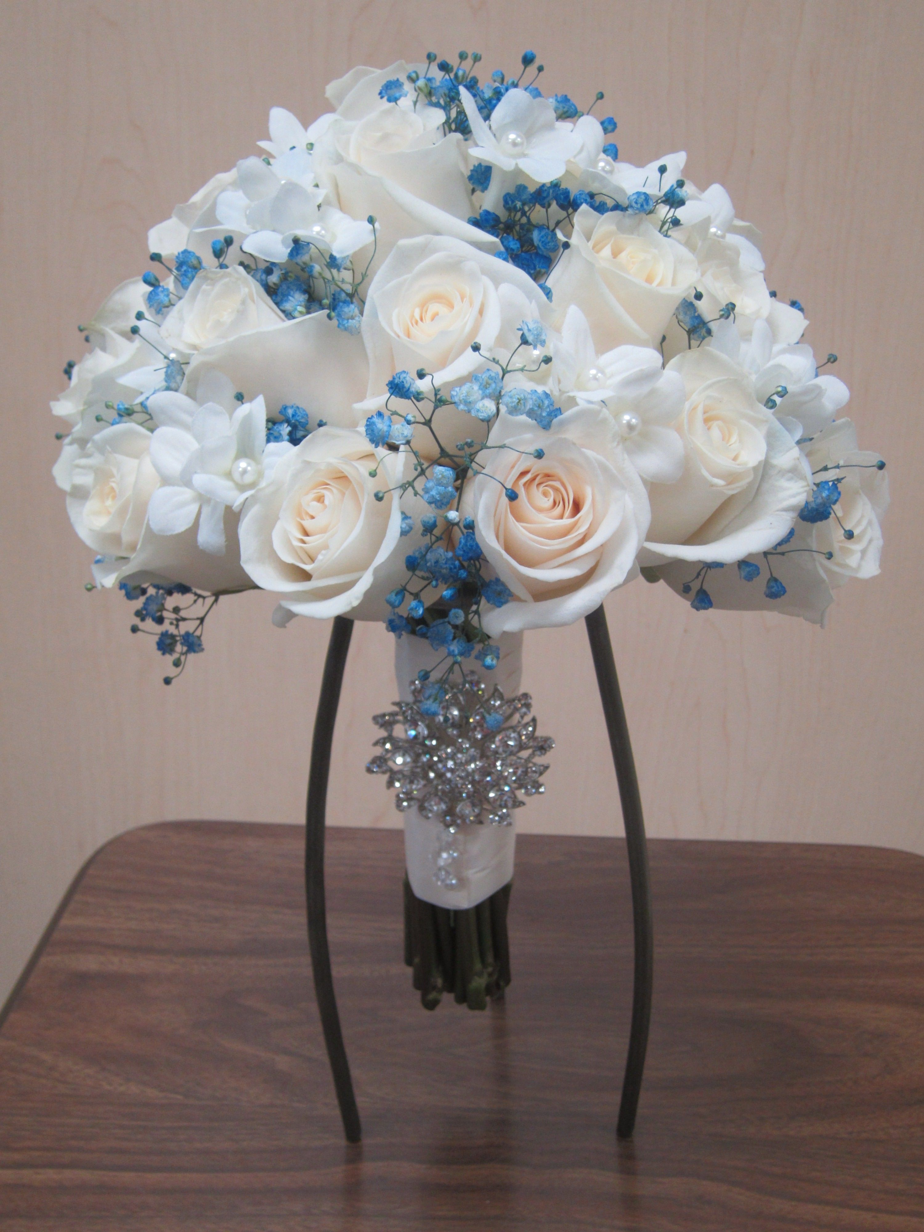 Beautiful White Bouquet Accented With Some Blue Gyp A Brooch Adds