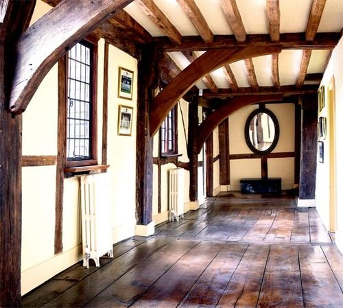 Upstairs hallway in a historic tudor manor house via for Houses with upstairs living