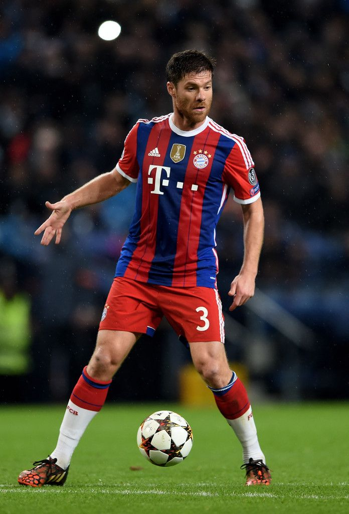 Xabi Alonso Of Bayern Muenchen Controls The Ball During The Uefa