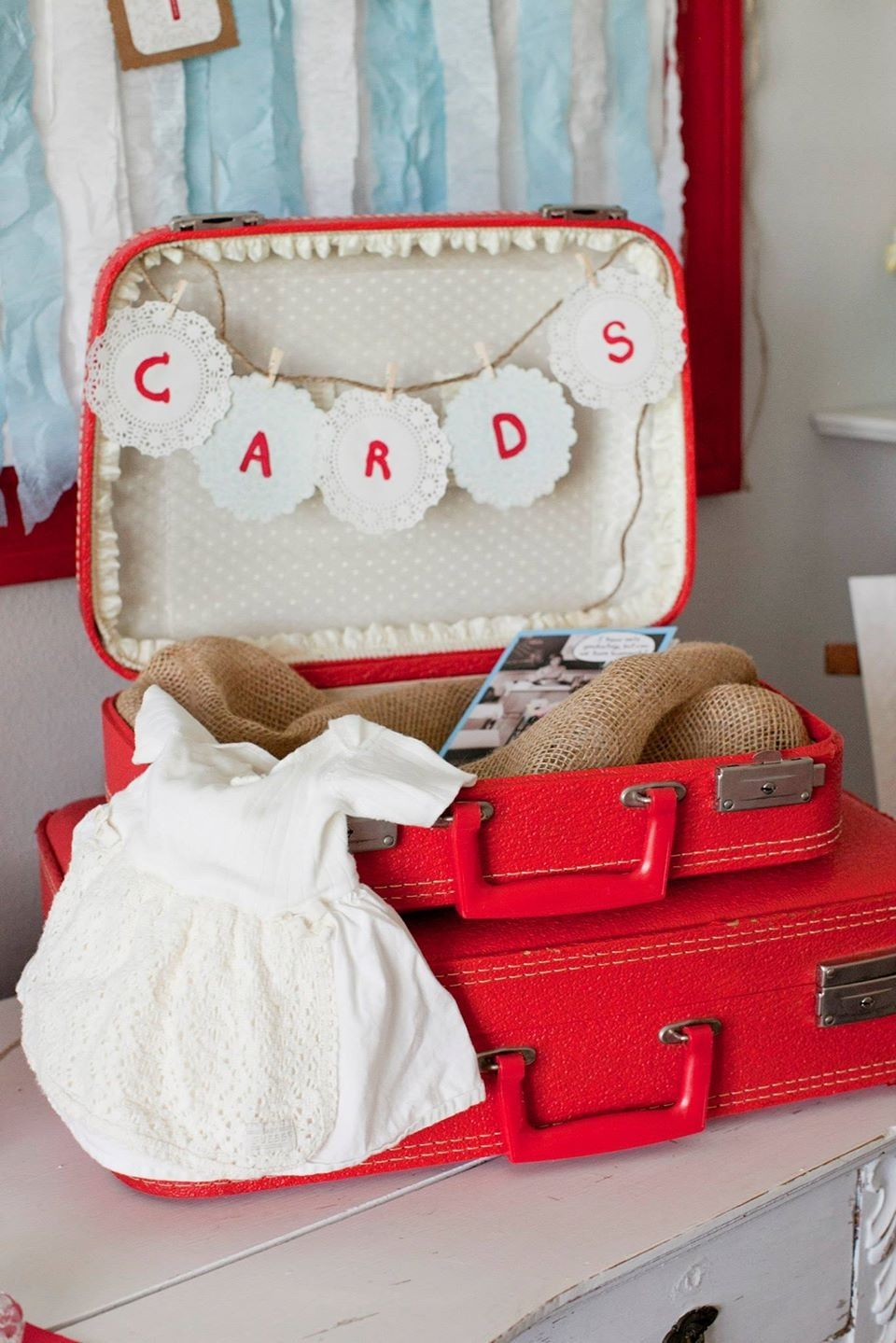 Vintage suitcase for graduation cards and graduate's baby dress.