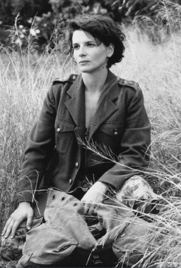 Juliette Binoche in a military jacket.