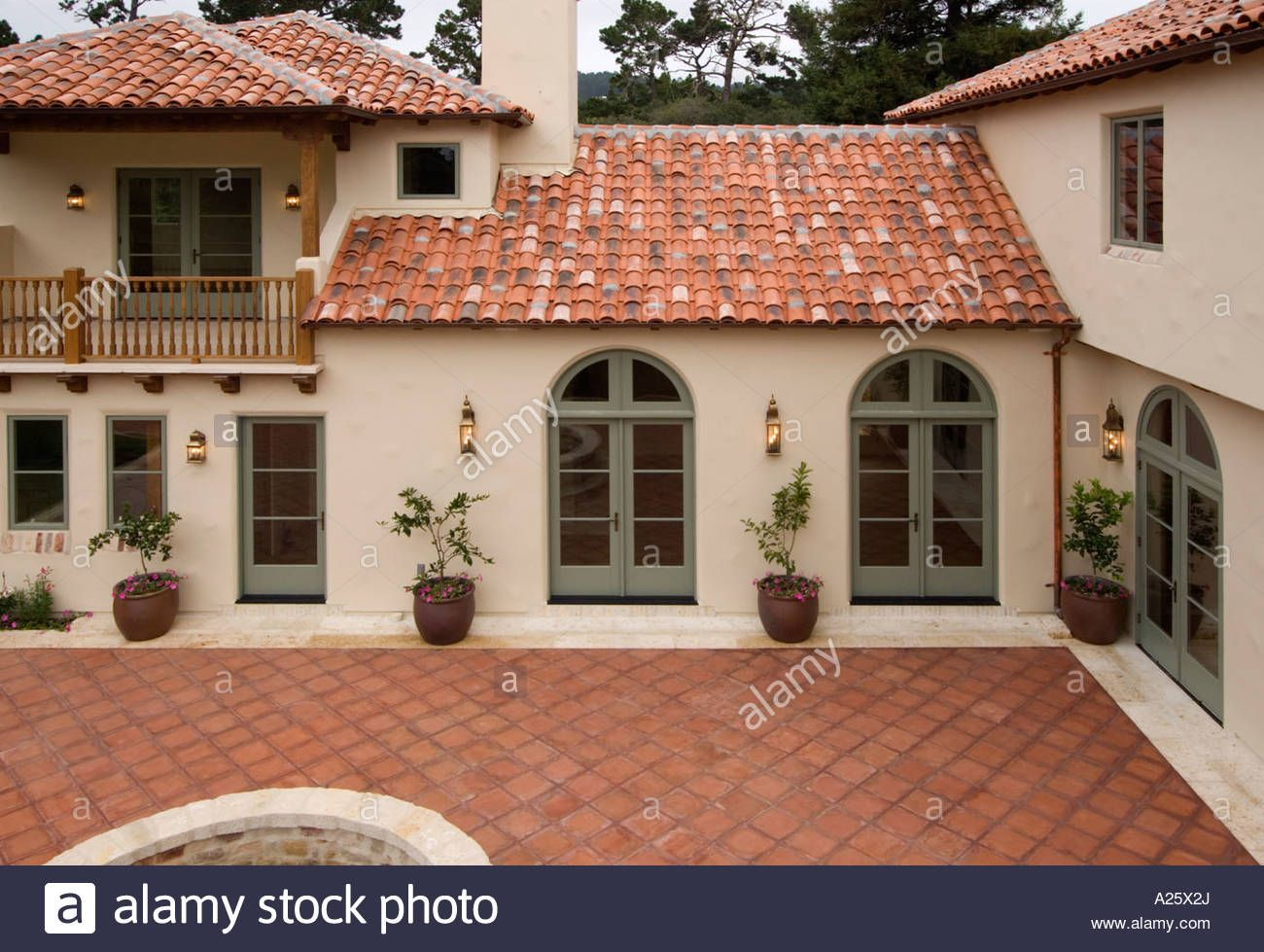 Exterior Of A Spanish Style Luxury Home With Stucco Walls A Red .
