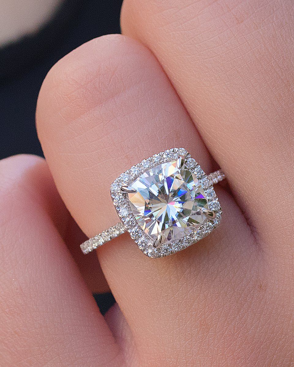 Accent diamonds surround your center stone for protection and added ...