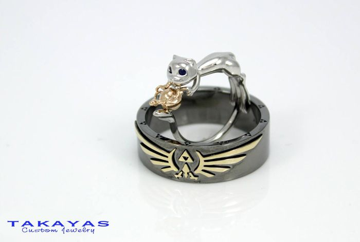 Melissa And Mike S Love With Zelda And Pokemon Mew Rings Takayas Custom Jewelry Geeky Engagement Rings Zelda Wedding Fan Jewelry