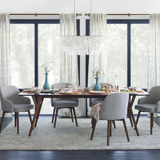 i wonder if a glass table will help your dining room seem bigger