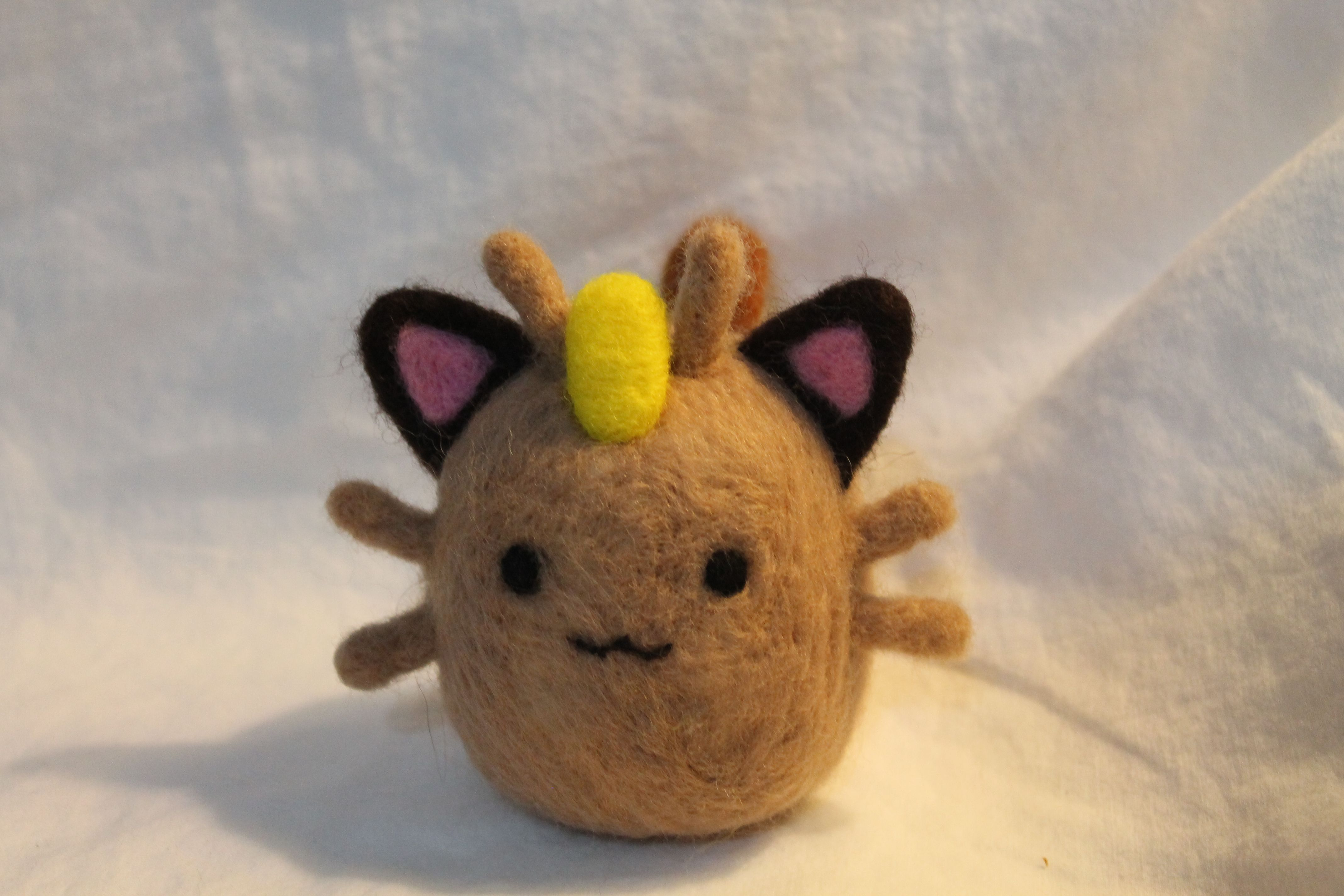 Meowth pokemon plush made from needle felted wool.