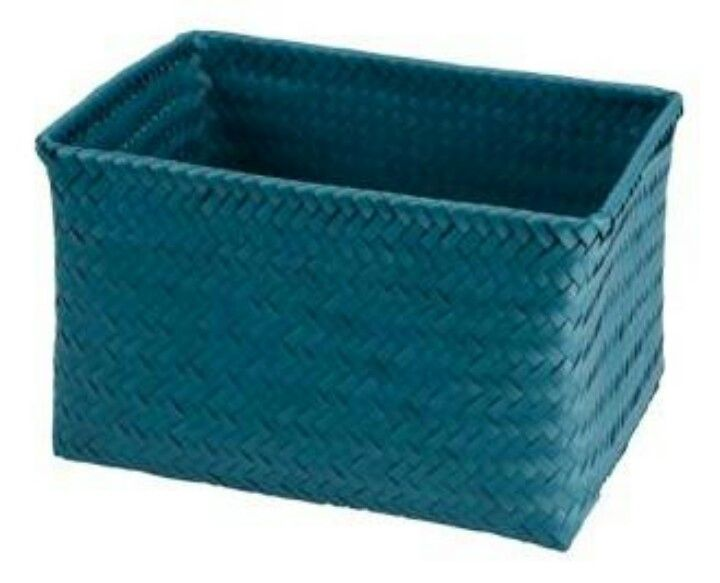 Teal wicker baskets under coffee table for.throws and ...