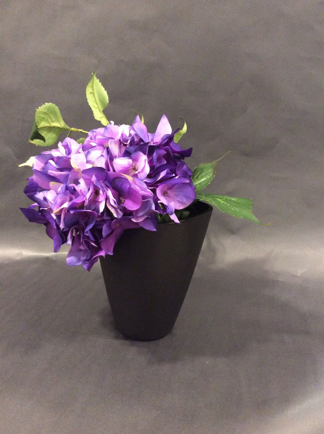 Violet Hydrangea with leaves in a Mat Black Glass container by OliVertByFlorence on Etsy