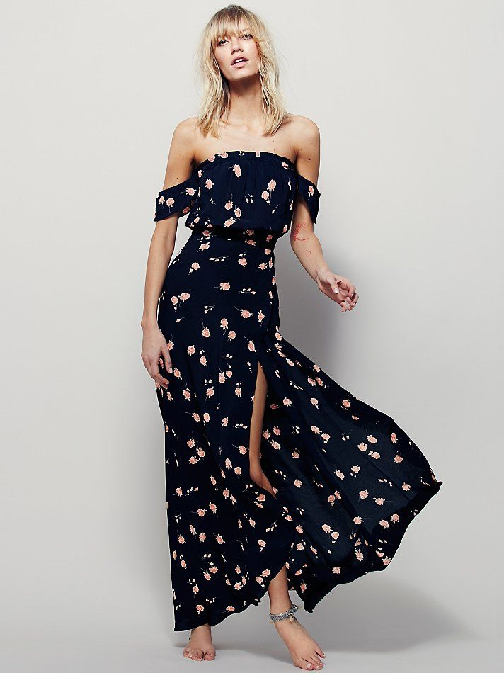 Bella Maxi | In an allover floral print, this American made off-the-shoulder maxi dress features super femme ruffle sleeve with an elastic neckline.  Faux wrap skirt with slit detailing.  Keyhole opening in back with hidden back zip.