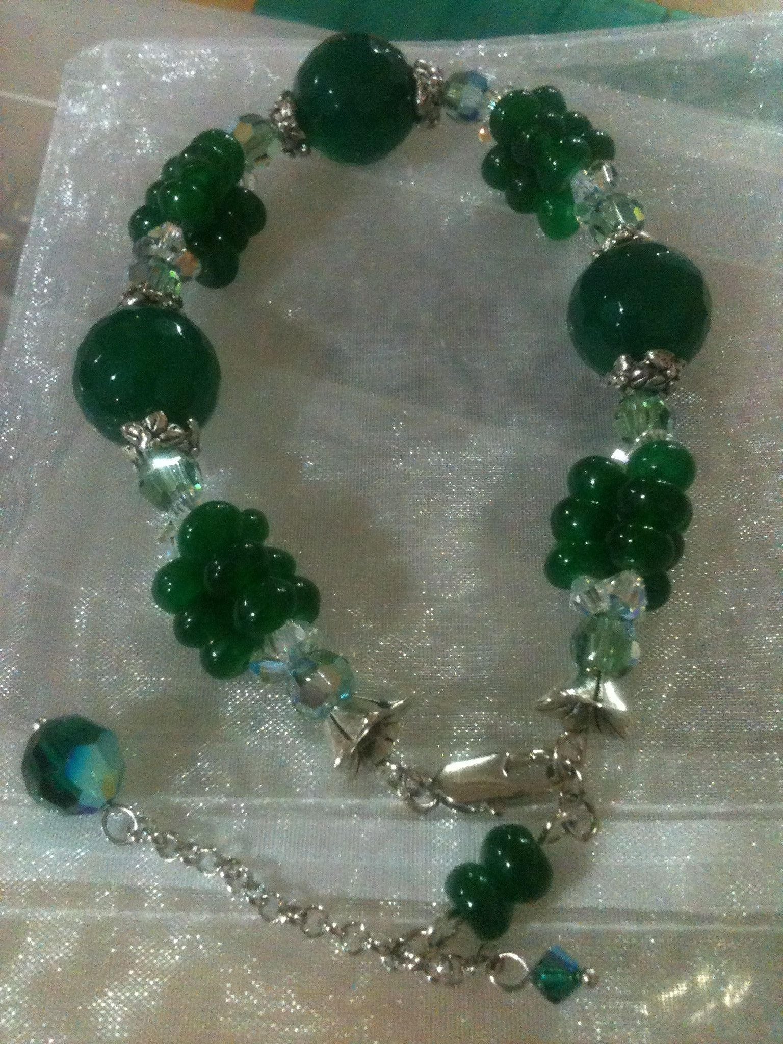 Green Bracelet 01 Materials : Jade Stones (kecubung), Swarovski, Metal Beads, Rodhium Chains, & Nylon String.