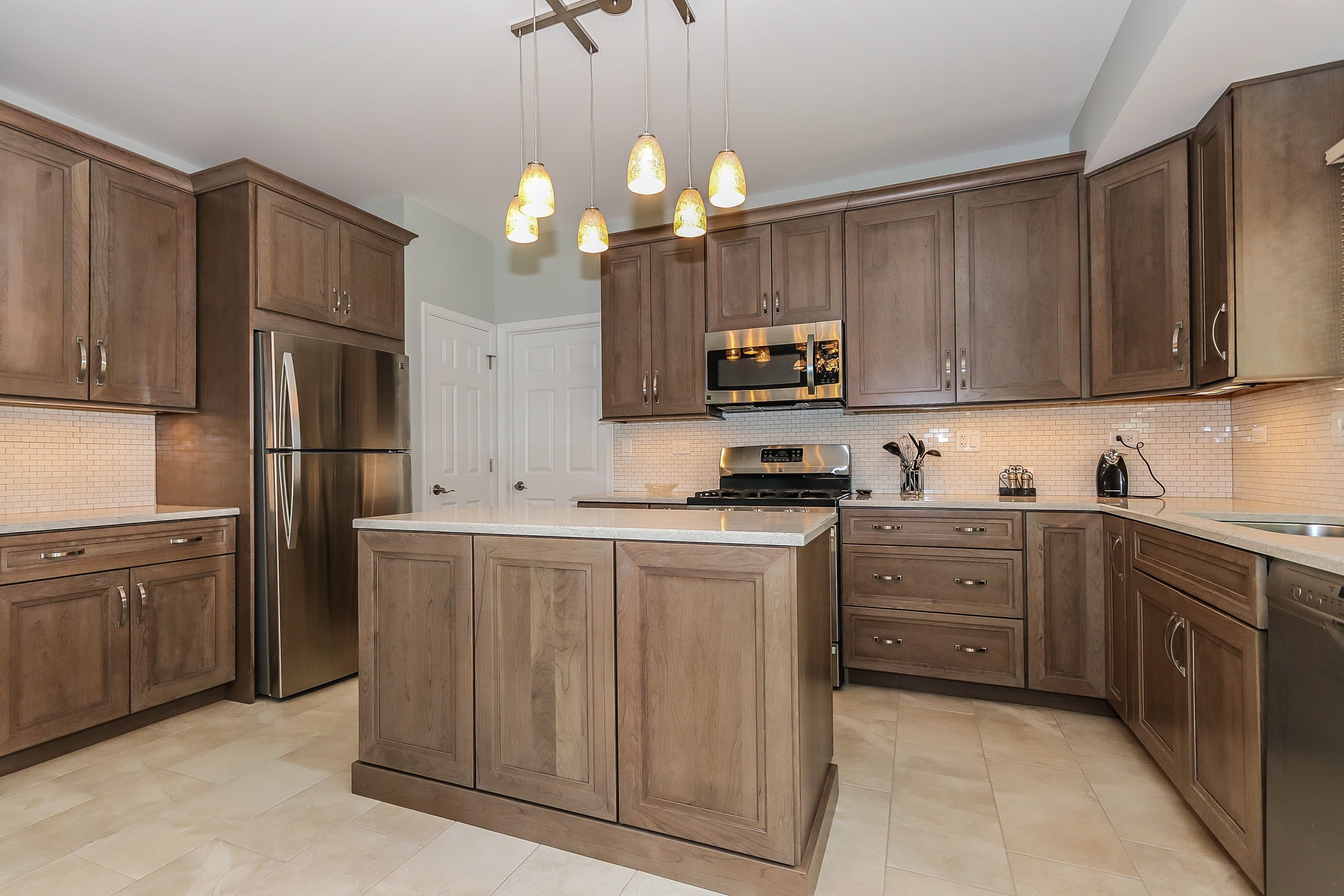 Bianco Drift Quartz By Ceasarstone Cherry Cabinets By Omega With A Stain Color Called Pumice Kitchen Remodel Staining Cabinets Professional Kitchen Design