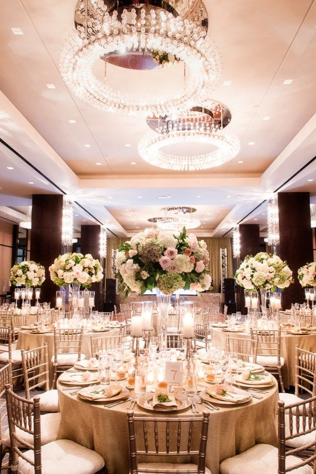 Gold and champagne colored floral arrangements Luxury
