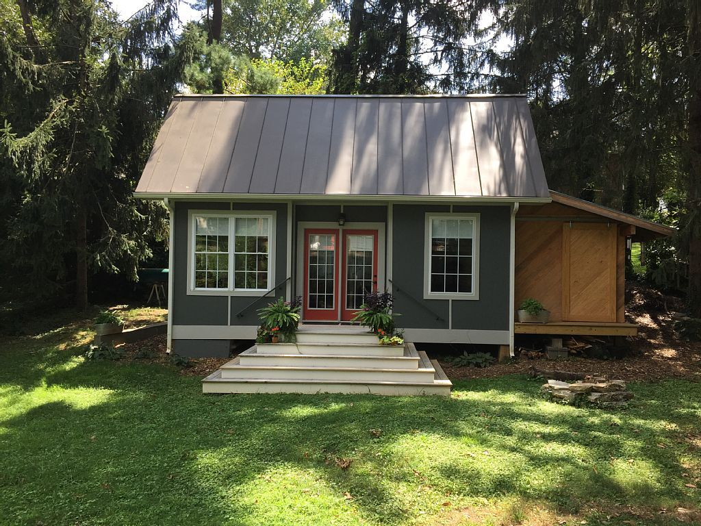 This 400 Sq Ft Cottage Is A Brand New Tiny Home Concept Space Boasting An Airy Entry Living Area Storage Tiny Houses For Rent Tiny House Rentals Tiny House