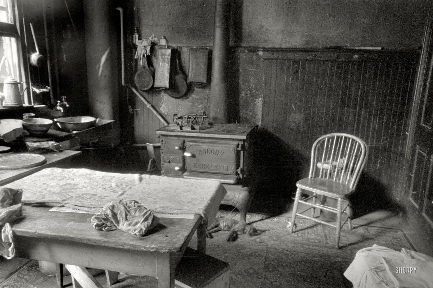 """November 1935. Washington, D.C. """"Kitchen in Negro home near Union Station."""" 35mm negative by Carl Mydans, Resettlement Administration. View full size."""