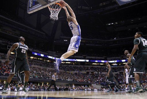 Dukes Plumlee scores with a reverse tip-in against Michigan State during their Midwest Regional NCAA mens basketball game in Indianapolis