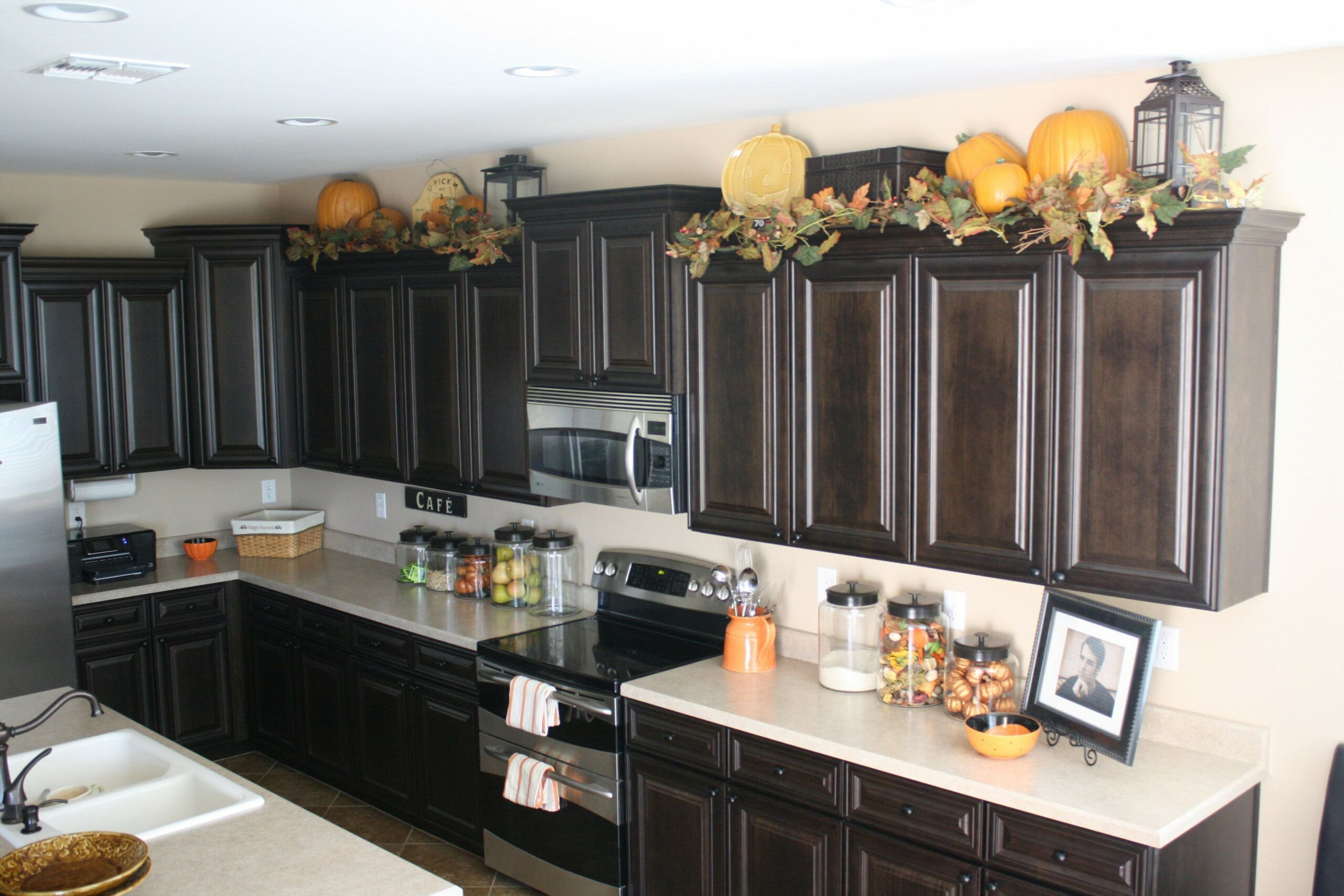 Seven Unexpected Ways Decorating Top Of Kitchen Cabinets Can Make Your Life In 2020 Top Kitchen Cabinets Decor Kitchen Cabinets Decor Decorating Above Kitchen Cabinets