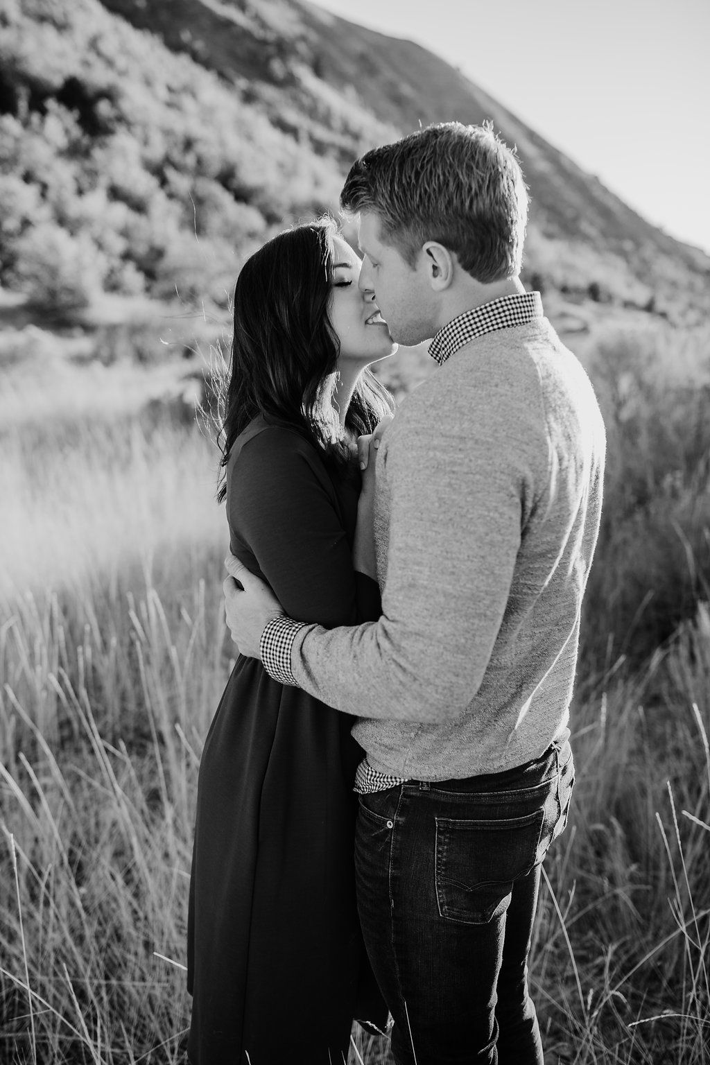 Black and white kissing hugging pose natural romantic engagement photos with calli richards adventurous couples photographer