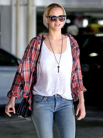 Plaid Simplicity...Jennifer Lawrence has her weekend look down to a tee (yeah, we went there). She pairs her Textile Elizabeth and James flannel with jeans, shades, a beanie and a structured Loeffler Randall mini bag for a laid-back, go-anywhere outfit.