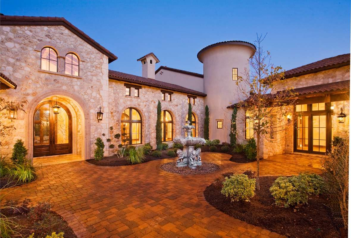 Entry courtyard of tuscan style home austin texas for Tuscan style house plans with courtyard