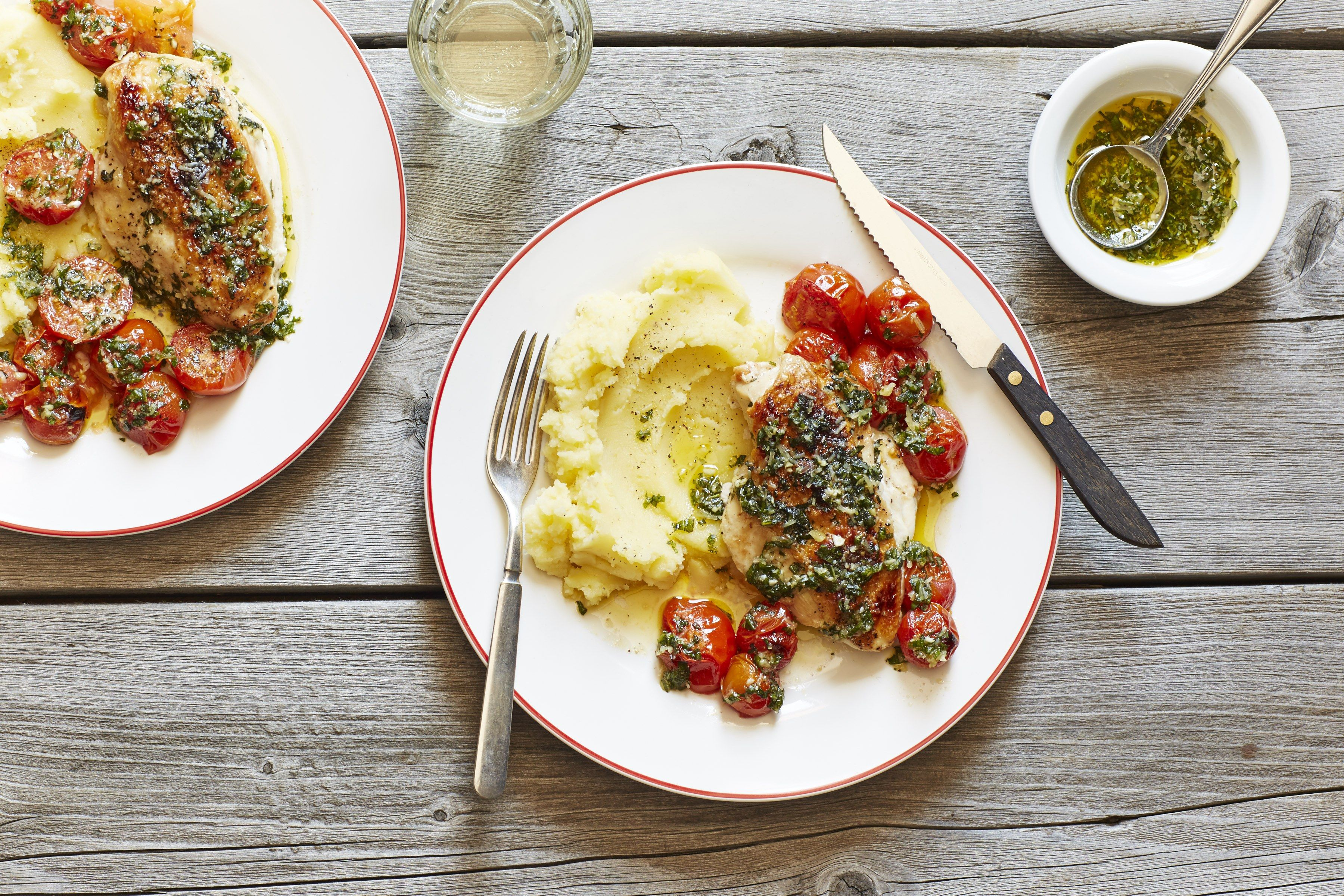 broiled chicken and tomatoes with olive oil mashed potatoes and pesto