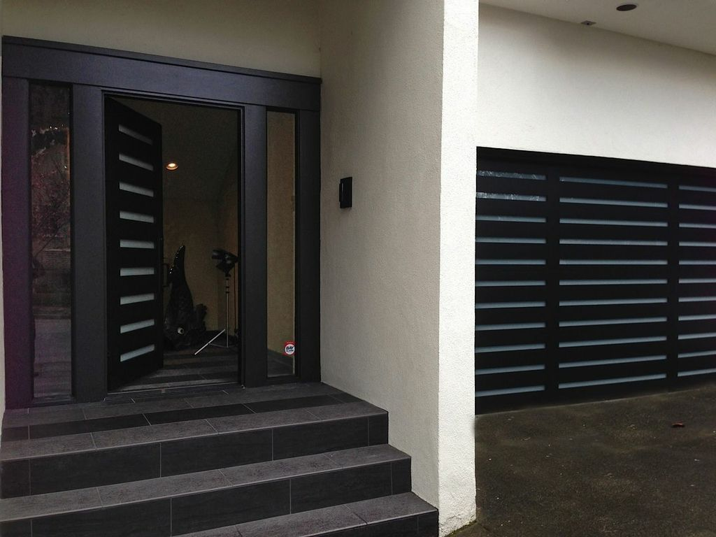 garage door with entry doorOur classic Moderno ExteriorFront Door with matching Garage Door