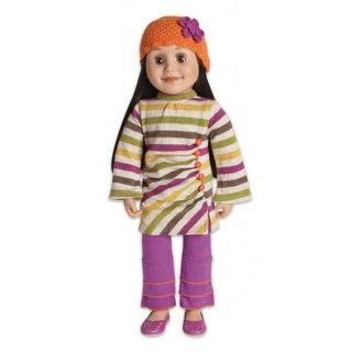 Urban Orange  Alexi heads out for a day in the city in her modern striped jersey tunic with flared sleeves.  The side-gathered detailed is punctuated with orange buttons.  Easy fitting pants with tier details are accented with orange stitching.  An orange beanie and purple shoes with a cut-out pattern complete the outfit.