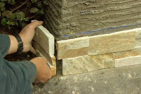 How to Cover a Concrete Wall with Stone Veneer | House landscape ...