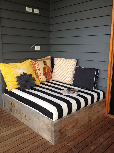 Might Be Too Much For Us But This Day Bed Situation Is A Fun Change Porch Love The Wood Frame W Striped Fabric