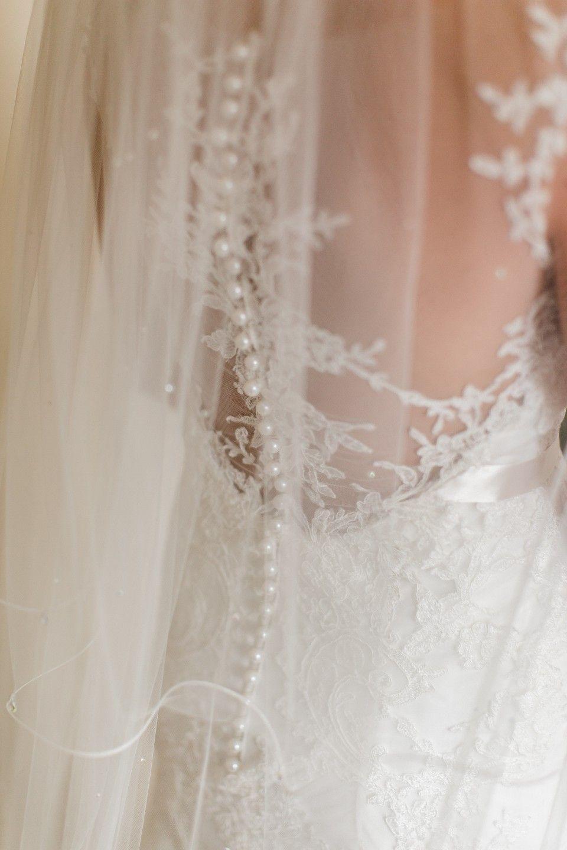 Wedding dress back  Wedding dress detail Lace wedding dress pearl buttons Wedding