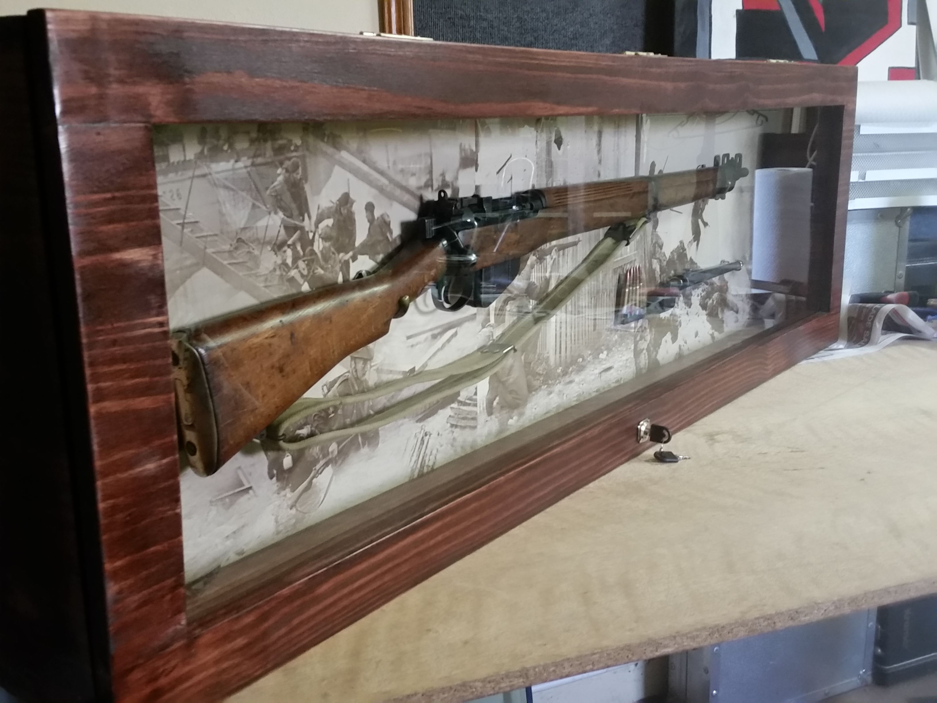 no closet storage ideas - The rifle in the display case with original bayonet and