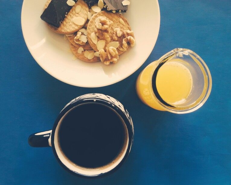 Coffee, fresh orange juice, marie biscuits, walnuts, full bodied dark chocolate with pistachios, slivered almonds