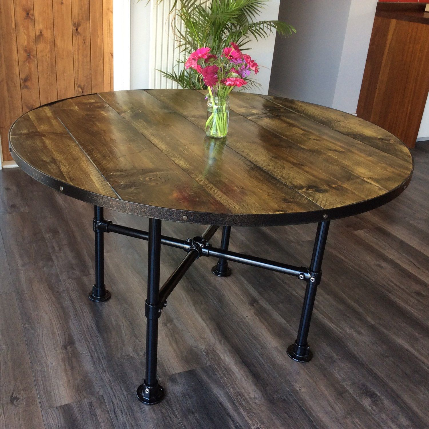 Barrel Top Table With Black Frame In An Aged Oak