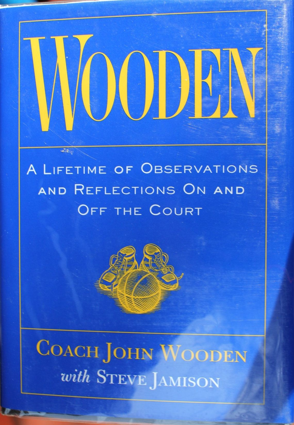 Wooden by John Wooden. Led UCLA to win 10 NCAA championships in 12 years,