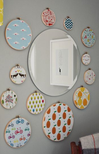 inexpensive embroidery hoops to display small pieces of beloved fabrics...easy, inexpensive artwork!
