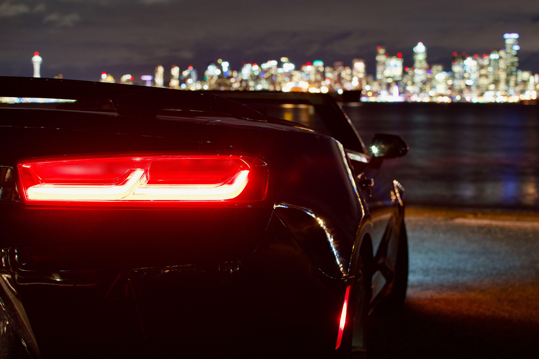 Black convertible coupe near shoreline Cars in 2020