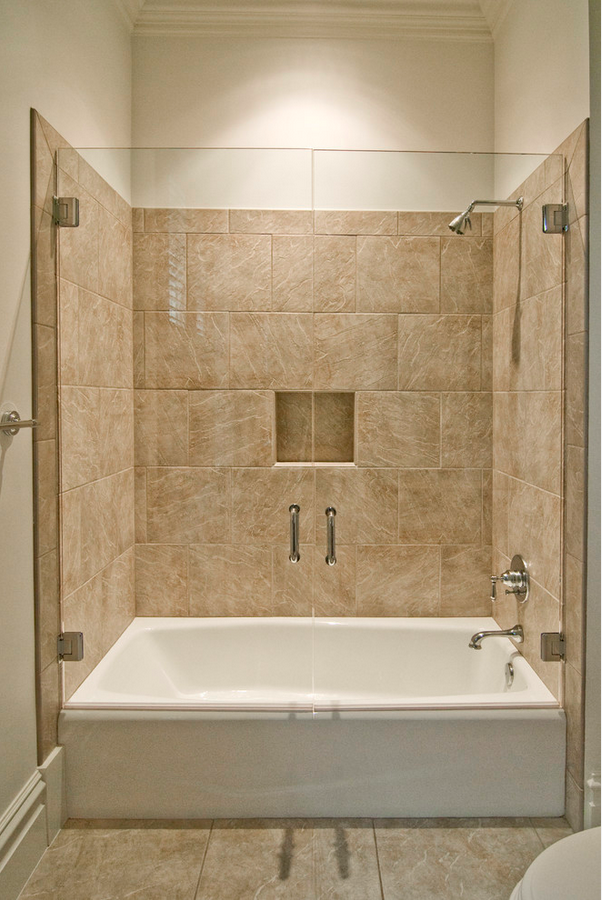 nice size tub with shower and double glass doors in 2019