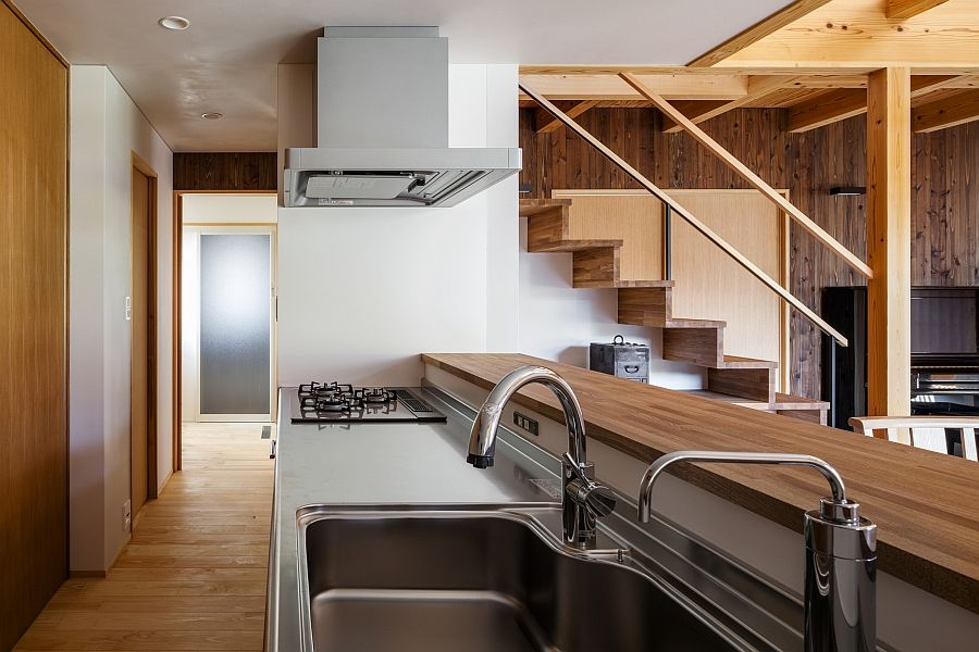 Modern kitchen with a wooden serving area