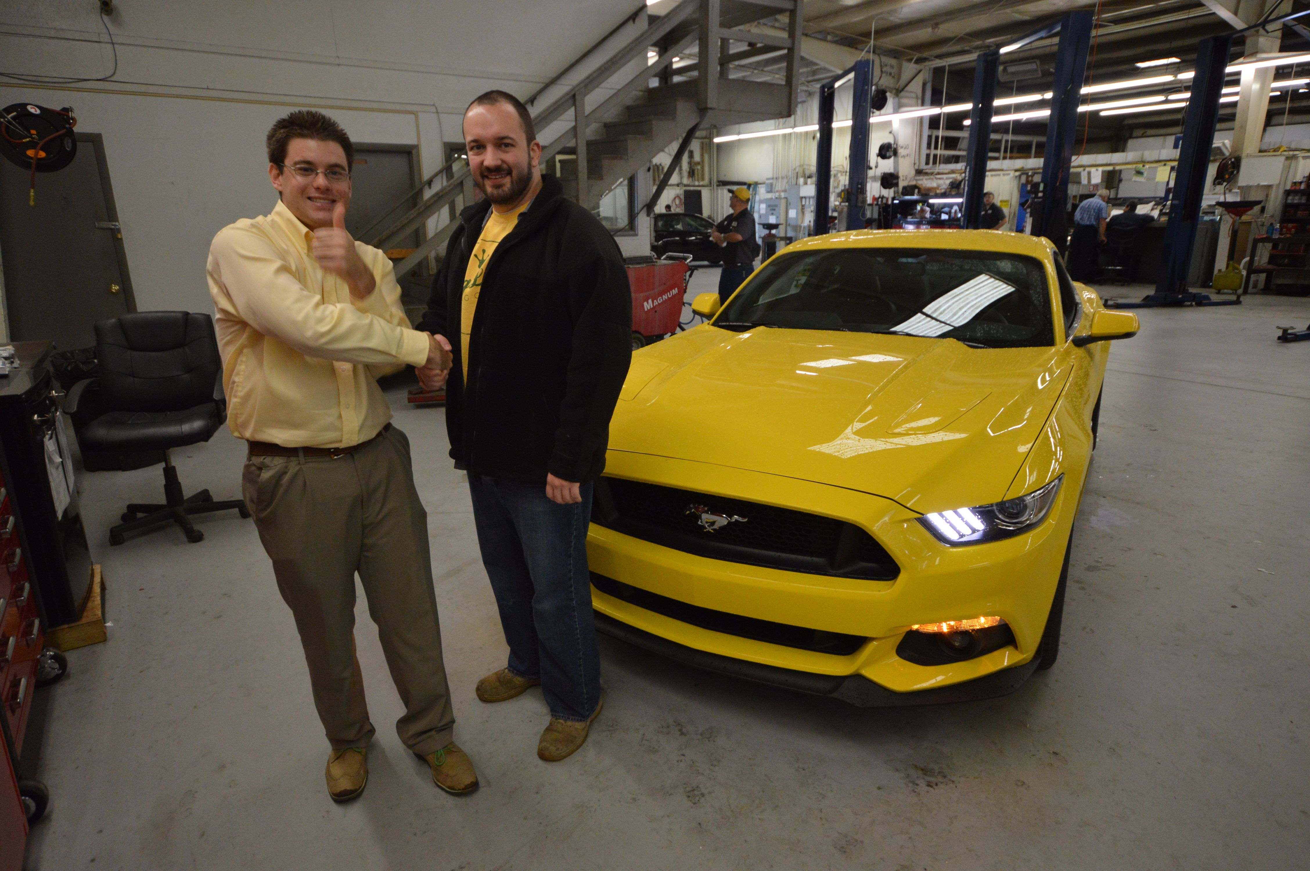 Straight from the truck to his driveway This Triple Yellow Mustang