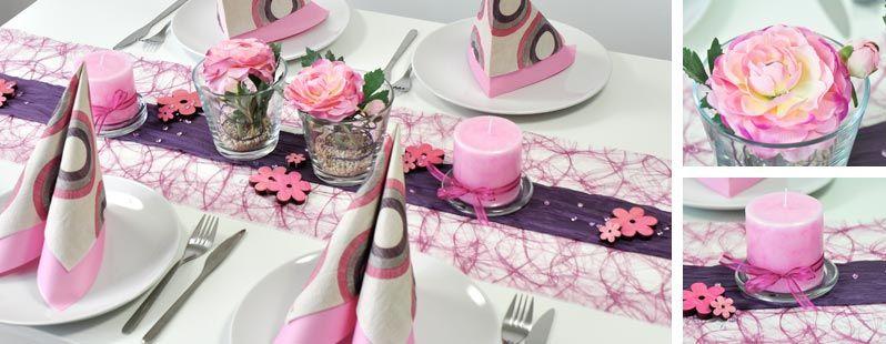 Tischdekoration in Erika und Aubergine und Ranunkeln in