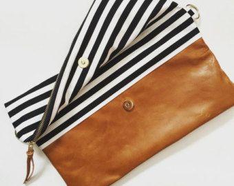 custom leather fold over clutch bag.