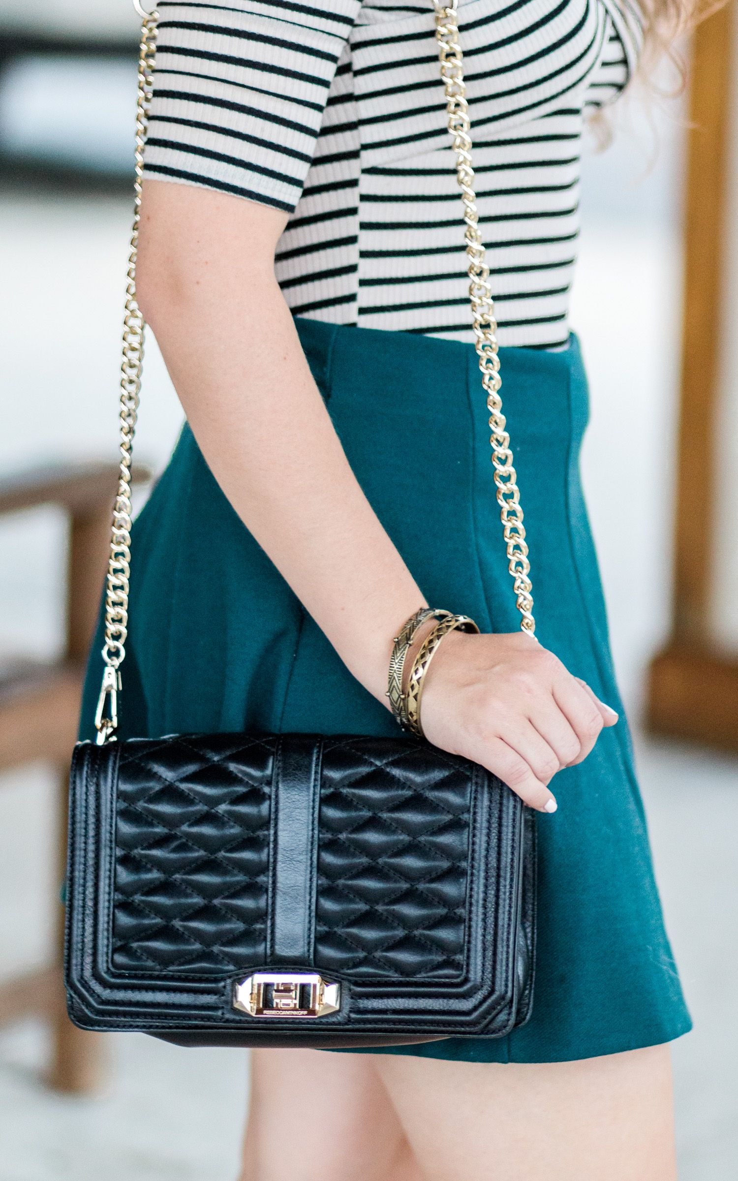 Rebecca Minkoff black and gold Love crossbody bag, antiqued gold bracelets, and a hunter green skater skirt styled by blogger Ashley Brooke Nicholas. Click through this pin to see this cute fall outfit idea + learn where to buy each item. #Zapposstyle #MyLuckyBrand sponsored by @zappos @luckybrandjeans