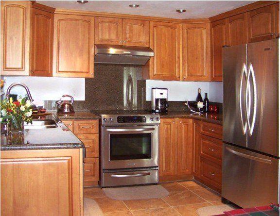 Honey Oak Kitchen Cabinets With Black Countertops Oak Cabinets