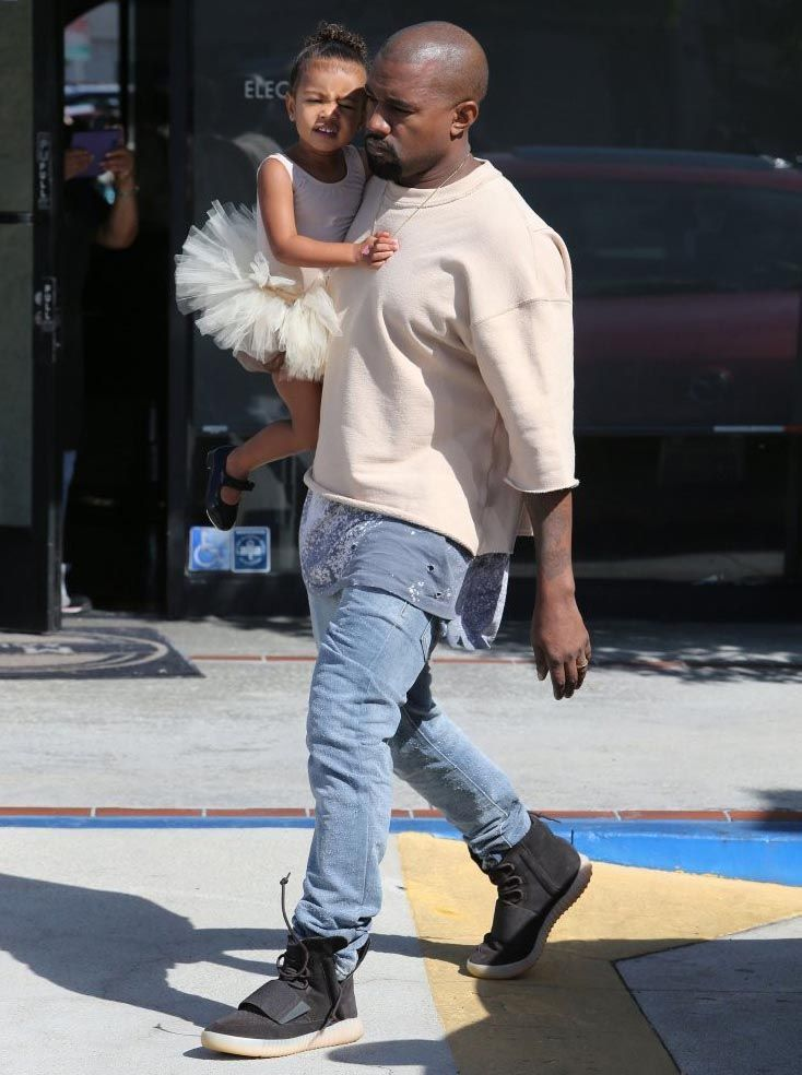best sneakers 718e3 326c4 KANYE WEST WEARS FEAR OF GOD SWEATSHIRT AND BLACK YEEZY 750 ...