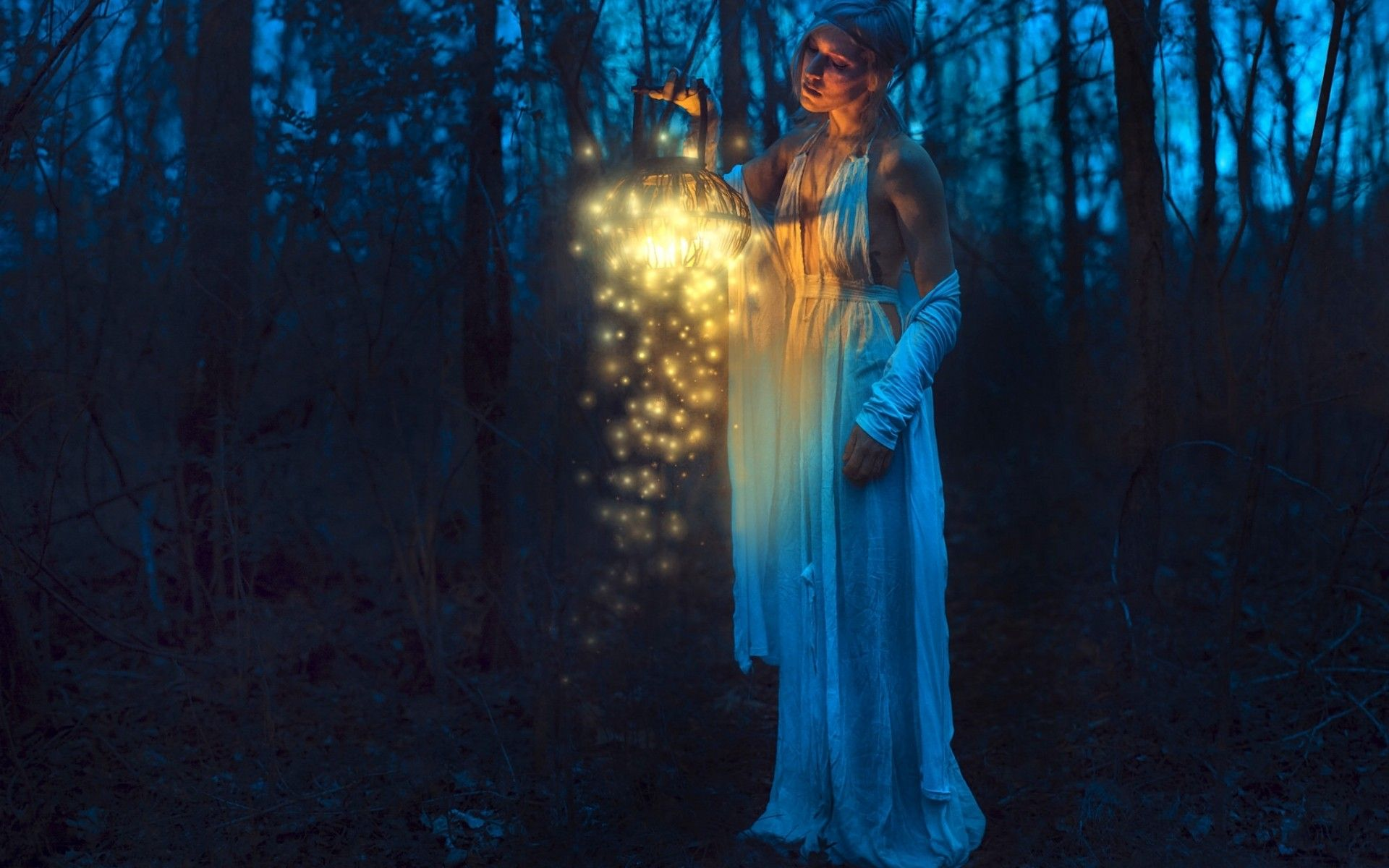 girl in white dress hand holding magic lantern in the dark forest ... for Girl Holding Lamp  268zmd